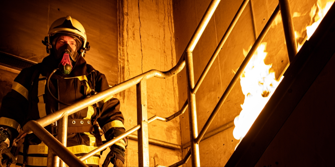 firefighter-standing-on-stairs-3448642